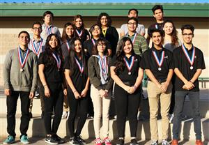 SLHS students pose with medals.